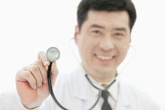 Doctor Holding Stethoscope, Close-up on Stethoscope Royalty Free Stock Photo