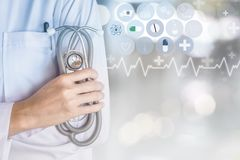 Doctor holding stethoscope in hand with modern medical technology background stock images