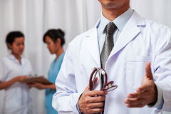 Doctor holding stethoscope and handing one hand Stock Photography