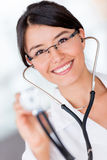 Doctor holding a stethoscope Stock Photos