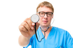 Doctor holding stethoscope and listens, portrait Royalty Free Stock Photos