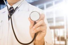 Doctor holding stethoscope Stock Photo