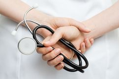 Doctor holding a stethoscope Royalty Free Stock Photo
