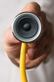 Doctor holding a stethoscope with a speaker in his hand Stock Photos