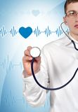 Doctor holding stethoscope Stock Images