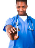 Doctor holding a syringe Royalty Free Stock Photography