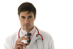 Doctor holding a syringe Royalty Free Stock Images