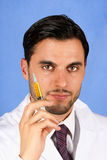 Doctor holding syringe Royalty Free Stock Photos