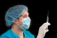 Doctor holding a syringe royalty free stock image