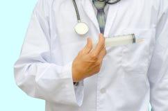 Doctor holding a syringe Stock Photo