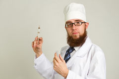 Doctor holding at a syringe Stock Image