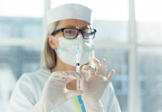 Doctor holding syringe Stock Photography