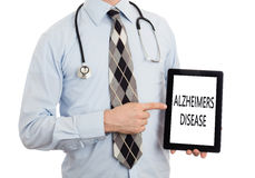 Doctor holding tablet - Alzheimers disease Royalty Free Stock Image