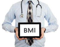 Doctor holding tablet - BMI Royalty Free Stock Photo