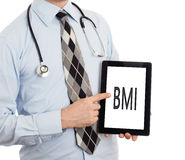 Doctor holding tablet - BMI Royalty Free Stock Images