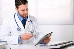 Doctor holding tablet and the box of medicine Royalty Free Stock Image