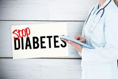 doctor holding tablet computer against prevention message background royalty free stock image