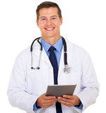 Doctor holding tablet computer Royalty Free Stock Images