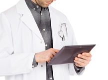 Doctor holding tablet with copy space and clipping path for the Royalty Free Stock Image
