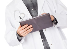 Doctor holding tablet with copy space and clipping path for the Stock Photos