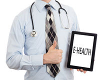 Doctor holding tablet - E-Health Stock Images