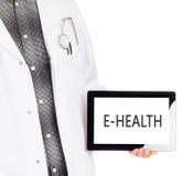 Doctor holding tablet - E-Health Stock Photos