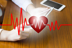 Doctor holding tablet with heart beat , E-Health concept , business concept , business idea.  stock photos