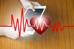 Doctor holding tablet with heart beat , E-Health concept , business concept , business idea.  stock photo