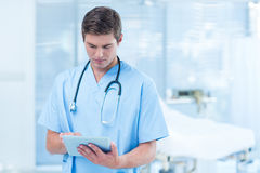 Doctor holding tablet Stock Image