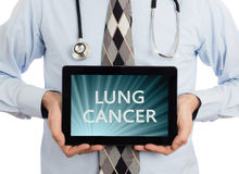 Doctor holding tablet - Lung cancer. Doctor, isolated on white backgroun, holding digital tablet - Lung cancer royalty free stock images