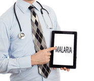 Doctor holding tablet - Malaria stock image