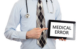 Doctor holding tablet - Medical error Stock Photography