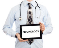 Doctor holding tablet - Neurology. Doctor, isolated on white backgroun, holding digital tablet - Neurology royalty free stock image