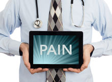 Doctor holding tablet - Pain Stock Photos
