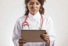 Doctor holding tablet pc stock photos