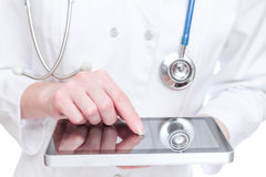 Doctor holding tablet PC Stock Photo