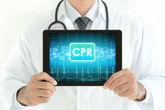 Doctor holding tablet pc with CPR sign on screen Stock Photos