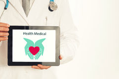 Doctor holding tablet pc with media illustration. royalty free stock images