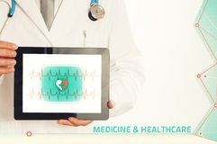 Doctor holding tablet pc with media illustration. stock photo