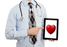 Doctor holding tablet - Red heart Stock Image