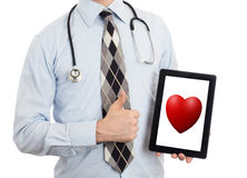 Doctor holding tablet - Red heart Stock Images