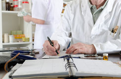 Doctor holding taking notes Royalty Free Stock Photo