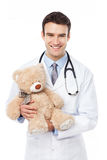Doctor holding teddy bear Royalty Free Stock Image