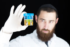 Doctor holding test tube Royalty Free Stock Image