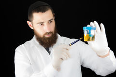 Doctor holding test tube. Stock Image