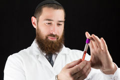 Doctor holding test tube. Stock Photography