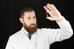 Doctor holding test tube. Stock Photo