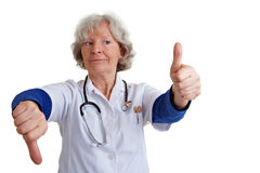 Doctor holding thumbs up and down Stock Photography