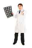Doctor holding tomography and showing thumbs up Royalty Free Stock Image