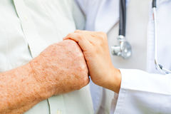 Doctor holding trembling hand Royalty Free Stock Photo